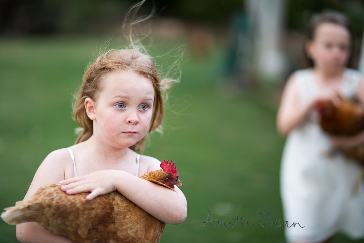 photo of little girl and her hen