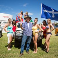 Photograph of young guy with ute and models at a ute muster