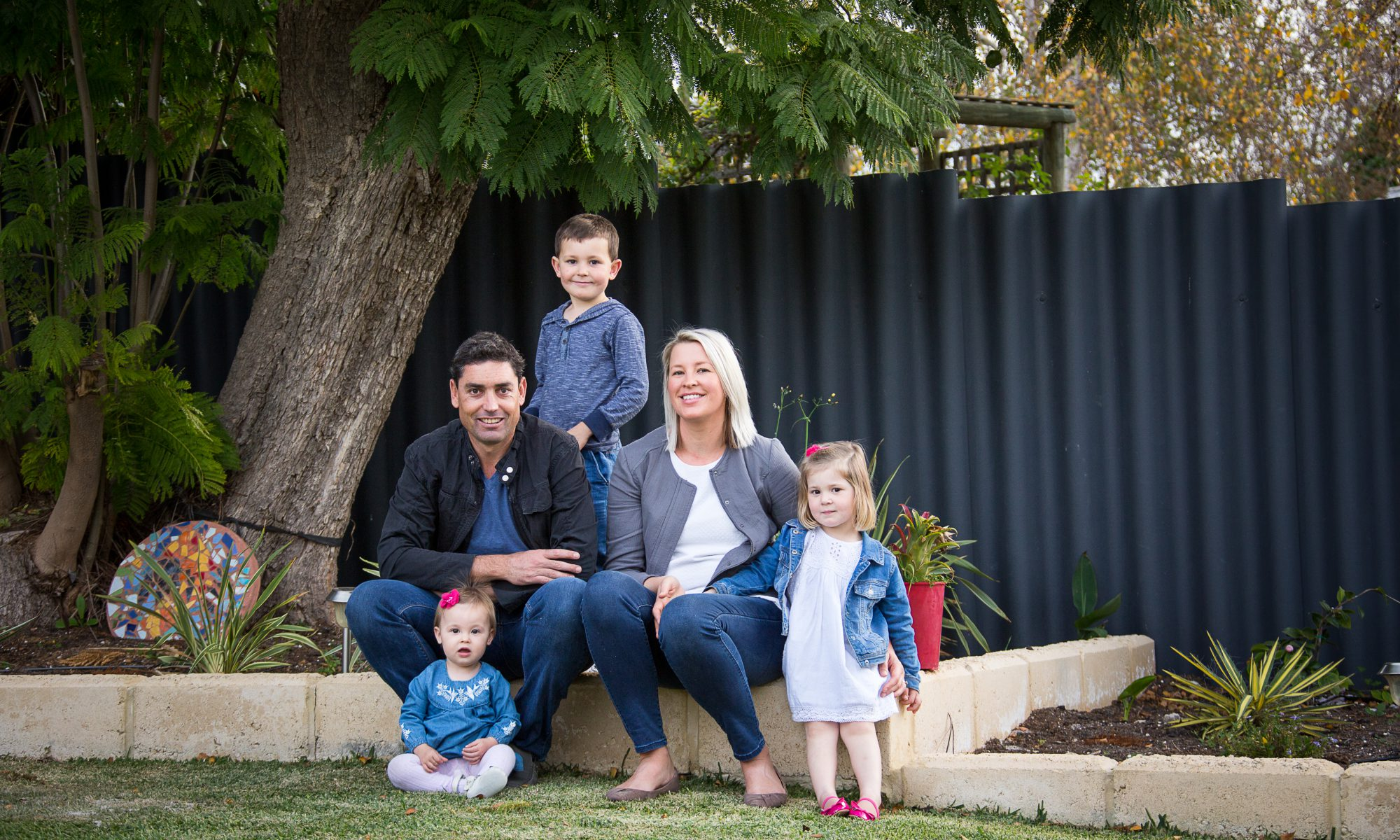 Photo of attractive young couple and their three children. Photo by Caro Telfer, Photographer