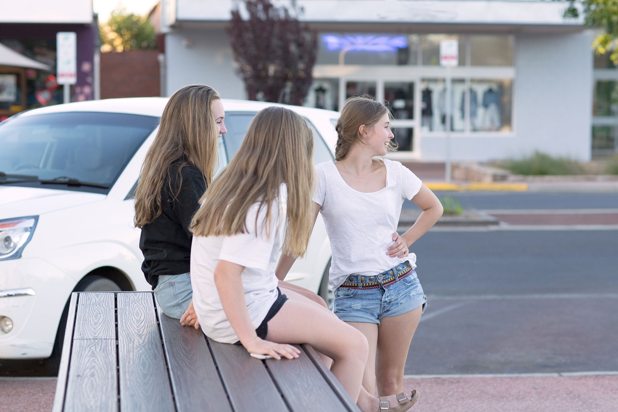 Stock photo of three teenage girls in the street, by caro telfer, photographer