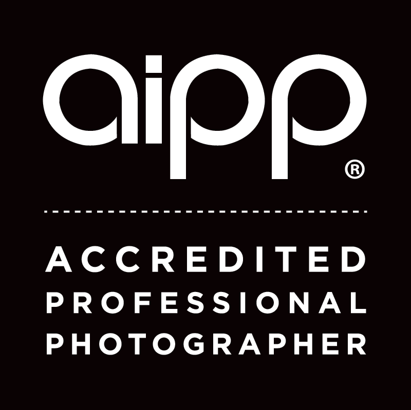 "The AIPP logo and the words ""Accredited Professional Photographer"""