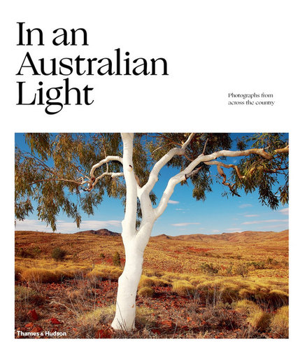 Cover of book with the title In an Australian Light with a photo of a white trunked eucalyptus tree in Central Australia, published by Thames and Hudson.