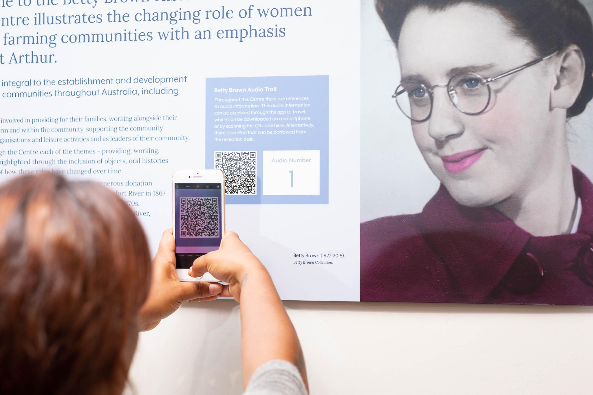 Museum visitor scanning QR code with smartphone. Photo by Caro Telfer.