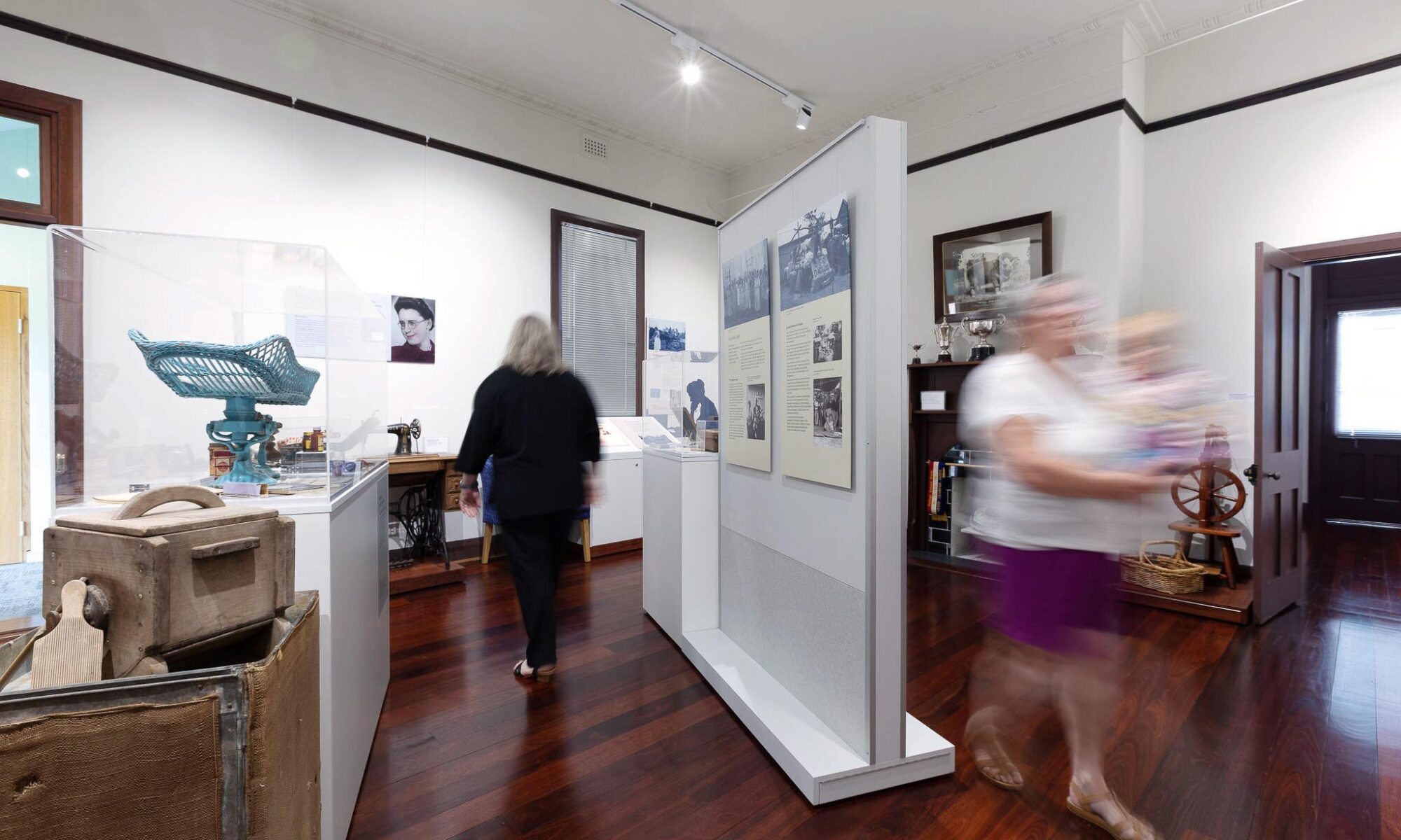 image of museum space showing historical displays and blurred people moving through the space.